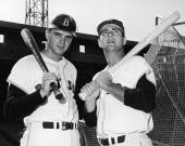 American baseball players Tony Conigliaro and Carl Yastrzemski of the Boston Red Sox pose with bats on their shoulders 1960s
