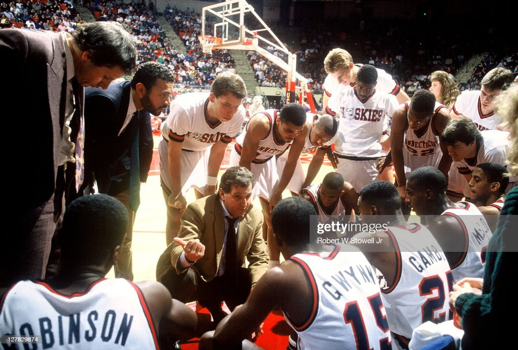 American basketball coach <a gi-track='captionPersonalityLinkClicked' href=/galleries/search?phrase=Jim+Calhoun&family=editorial&specificpeople=208977 ng-click='$event.stopPropagation()'>Jim Calhoun</a> (center, in tan blazer) of the University of Connecticut talks to his team during a timeout, Hartford, Connecticut, 1988.