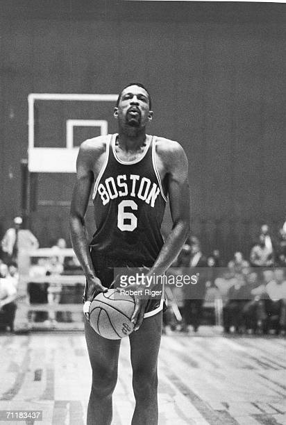 American basketball player Bill Russell of the Boston Celtics breathes deeply as h lines up a free throw during a game late 1950s or 1960s