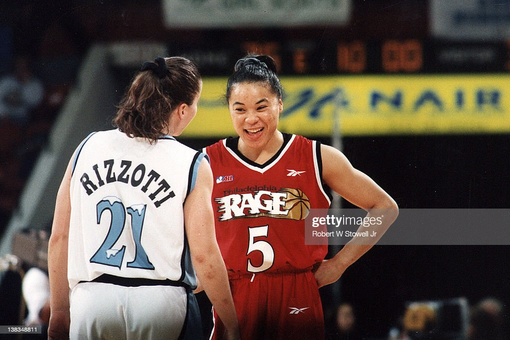 American basketball player <a gi-track='captionPersonalityLinkClicked' href=/galleries/search?phrase=Dawn+Staley&family=editorial&specificpeople=209196 ng-click='$event.stopPropagation()'>Dawn Staley</a> of the Philadelphia Rage jokes with Jennifer Rizzotti of the New England Blizzard during a game, Springfield, Massachusetts, 1997.