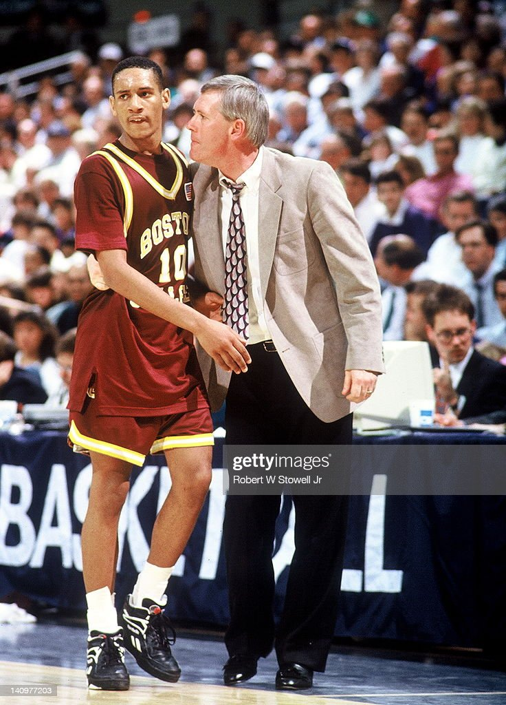 American basketball player Howard Eisley of Boston College listens to his coach Jim O'Brien during a game against University of Connecticut Storrs...