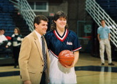 American basketball player Kerry Bascom of the University of Connecticut holds the game ball as she poses with Italianborn American coach Geno...