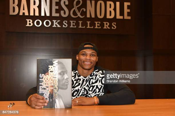 American basketball player Russell Westbrook with his book 'Russell Westbrook Style Drivers' at Barnes Noble at The Grove on September 14 2017 in Los...
