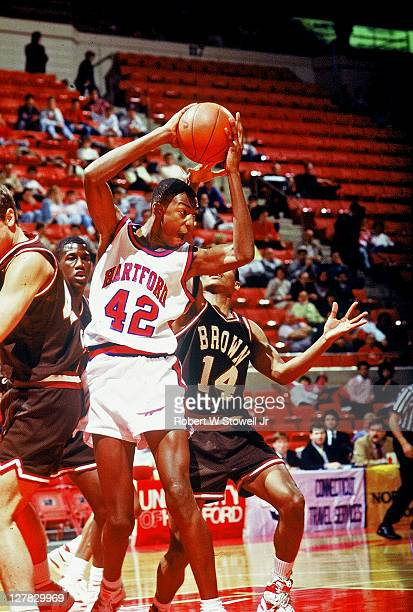 American basketball player Vin Baker of the University of Hartford with the ball during a game against Brown University Hartford Connecticut 1990