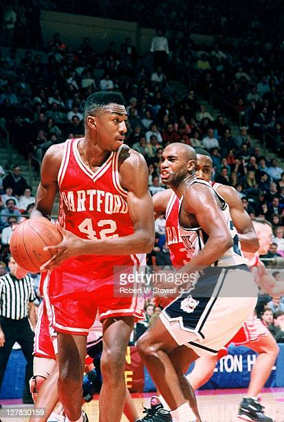 American basketball player Vin Baker of the University of Hartford with the ball during a gane against the University of Connecticut Hartford...