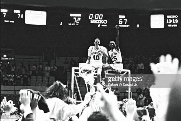 American basketball players Jeff King and Phil Gamble of the University of Connecticut celebrate their team's National Invitation Tournament...