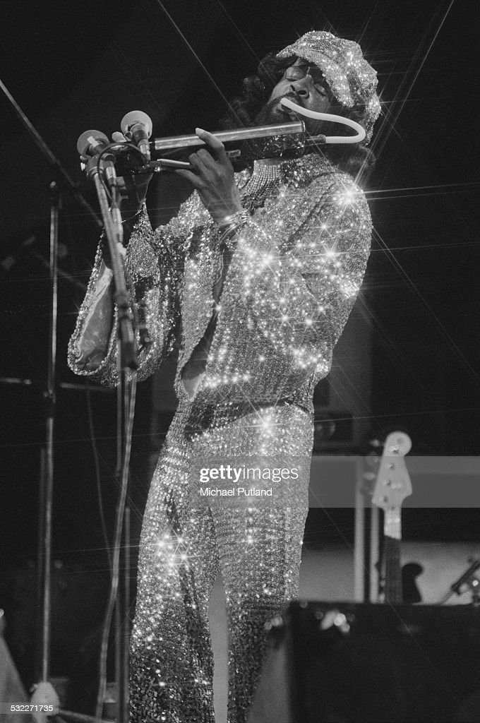 American bassist Larry Graham playing a melodica on stage with funk group Graham Central Station, 20th January 1975.