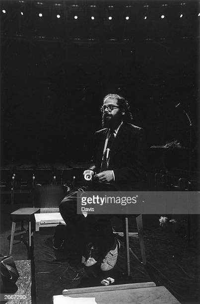 American Beat poet Allen Ginsberg rehearsing for a poetry reading at the Royal Albert Hall in London
