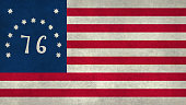 Historic American national flag, the 1776 Bennington flag with grungy worn distressed textures