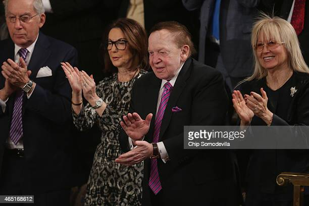 American billionaire casino mogul Sheldon Adelson and his wife Miriam Adelson applaud for Prime Minister Benjamin Netanyahu of Israel as he addresses...