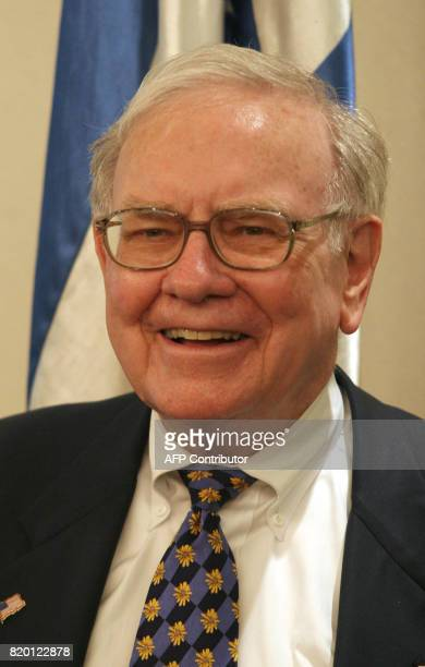 American billionaire Warren Buffett looks on prior to a meeting with Israeli Prime Minister Ehud Olmert at his Jerusalem office 18 September 2006...