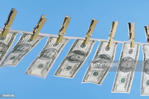 American bills hanging on clothesline