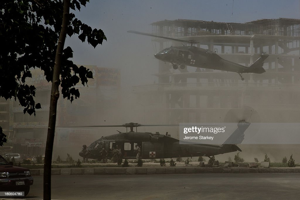 CONTENT] American Black Hawk Helicopters swoop in to a roundabout in western Kabul to collect a New Zealand SAS soldier, Corporal Doug Grant, mortally wounded during a seven hour gunbattle to retake control of the British Council building, Aug 19, 2011. Eyewitnesses said a suicide bomber breached the perimeter of the compound at around 5.30am, on the day Afghanistan marks its independence from colonial rule. A series of explosions, bursts of fire and single shots were heard throughout the day. French. American, New Zealand and British forces all responded to the attack, despite handing responsibility to Afghan forces earlier this year.