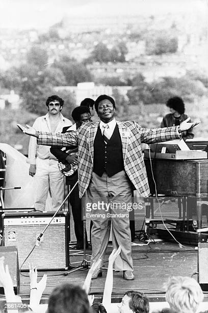 American blues musician B B King being the showman on stage at an outdoor concert