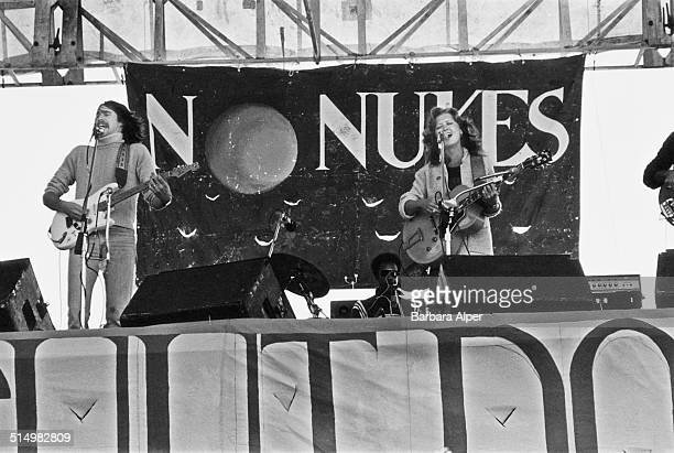 American blues singer and songwriter Bonnie Raitt performs at an antinuclear concert in Battery Park New York City 23rd July 1979
