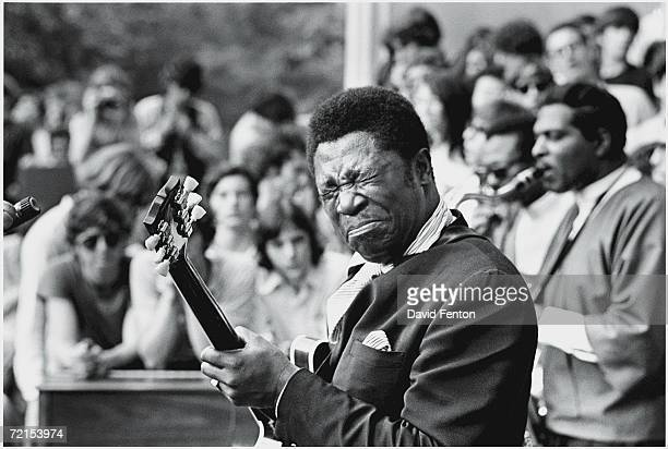 American blues singer songwriter and guitarist BB King plays the guitar with his eyes clenched closed as he performs on stage at Central Park New...