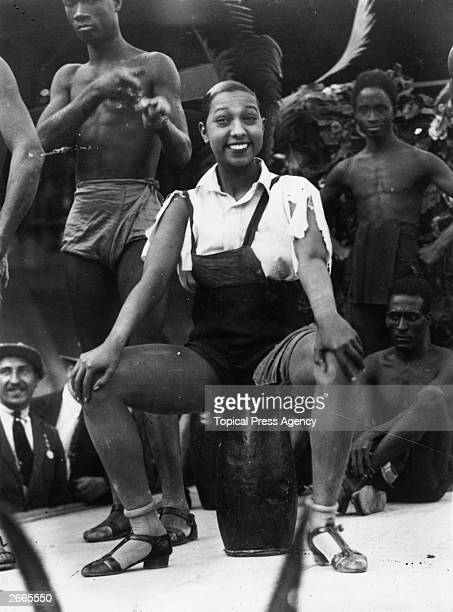American born singer and dancer Josephine Baker surrounded by male dancers at the Folies Bergere