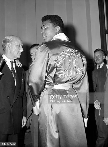 American boxer Cassius Clay in his dressing room at the London Palladium wearing a robe that leaves his opponents and the public in no doubt who he...