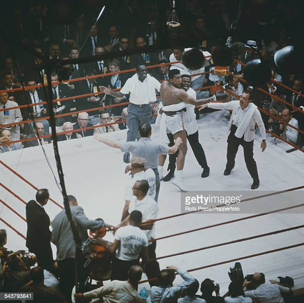 American boxer Cassius Clay is congratulated by his cornerman Drew Bundini Brown and trainer Angelo Dundee after beating Sonny Liston to become the...