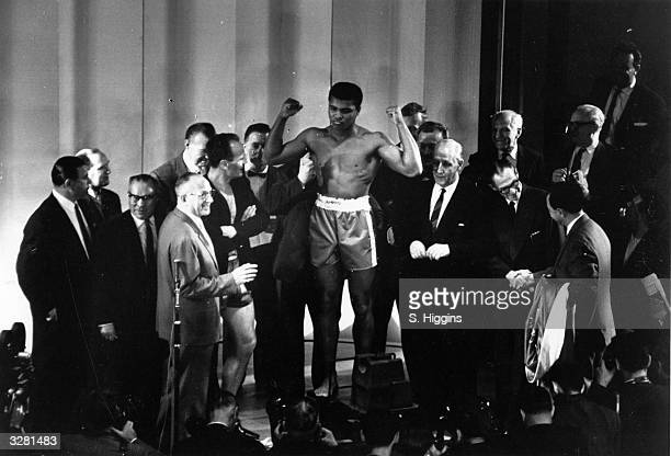 American boxer Cassius Clay weighs in before his world heavyweight title fight against British boxer Henry Cooper