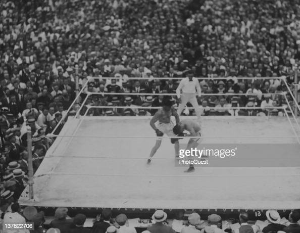 American boxer Jack Dempsey fights French boxer Georges Carpentier in the ring at at Boyle's Thirty Acres Jersey City New Jersey July 2 1921 Billed...