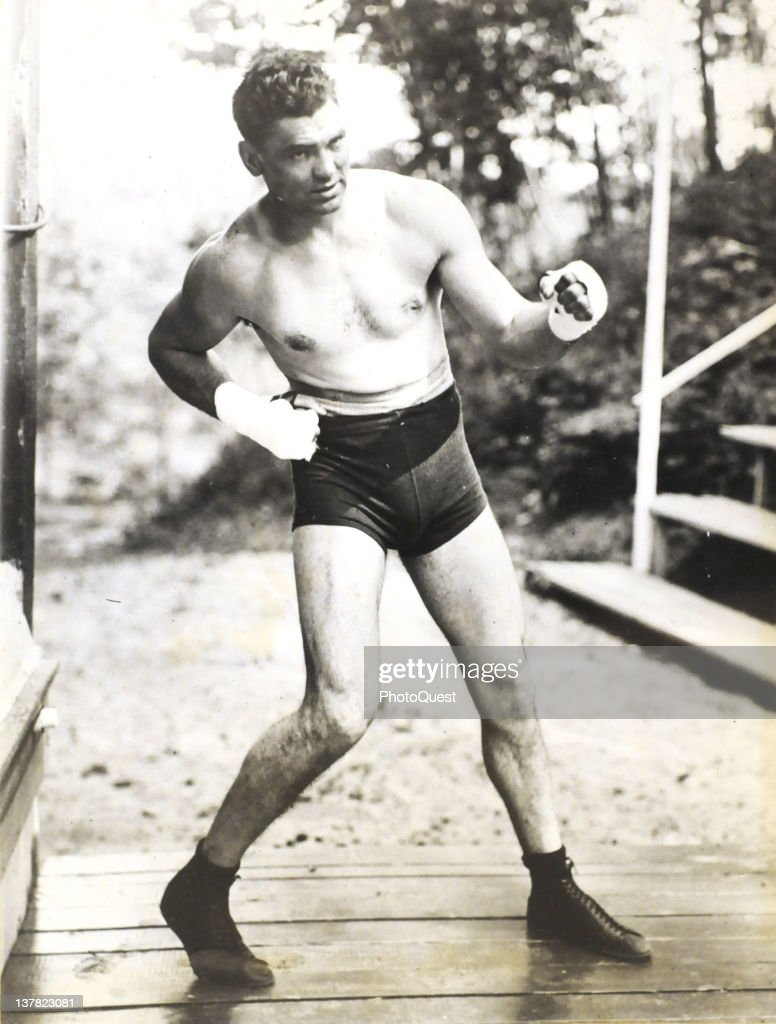 American boxer <a gi-track='captionPersonalityLinkClicked' href=/galleries/search?phrase=Jack+Dempsey+-+Boxer&family=editorial&specificpeople=15348667 ng-click='$event.stopPropagation()'>Jack Dempsey</a> (1895-1983) strikes a pose during training, Michigan City, Indiana, 1922.