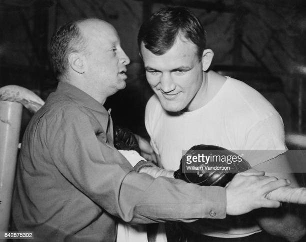 American boxer Joe Baksi with his trainer Whitey Bimstein in London before his fight with Freddie Mills in Harringay 23rd October 1946