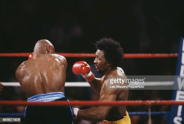 American boxer Marvelous Marvin Hagler pictured left in dark shorts in action against fellow American boxer Thomas Hearns in yellow shorts in a fight...