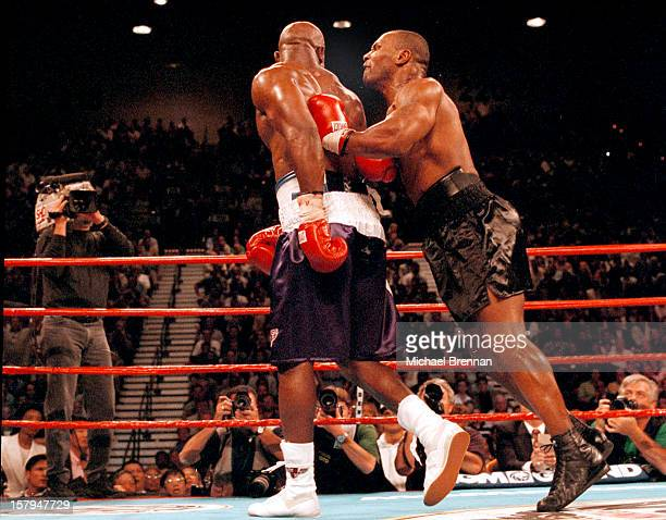 American boxer Mike Tyson bites Evander Holyfield's right ear during a fight at the MGM Grand Hotel and Casino Las Vegas 28th June 1997