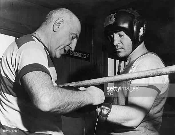 American boxer Rocky Graziano at his training camp at Greenwood Lake New York State with his trainer Harry Lenny 13th June 1950 At the time Graziano...
