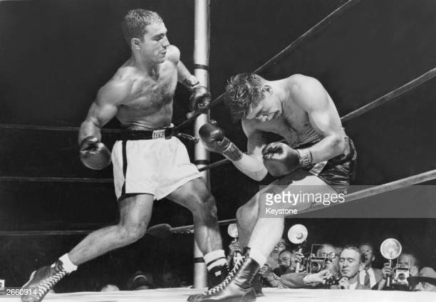 American boxer Rocky Marciano batters Roland La Starza against the ropes in the 11th round of their heavyweight contest at the Polo Grounds New York...