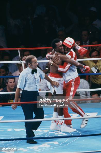 American boxer Sugar Ray Leonard hugs his corner man after beating Thomas Hearns to become undisputed world welterweight champion in a fight dubbed...