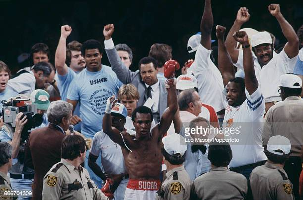 American boxer Sugar Ray Leonard raises his arms in the air after beating Thomas Hearns to become undisputed world welterweight champion in a fight...