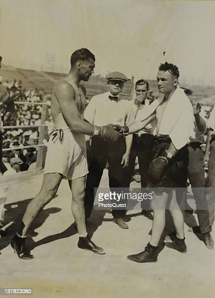 American boxers Jack Dempsey and Tommy Gibbons shake hands in an outdoor ring just prior to their bout Shelby Montana July 4 1923 Dempsey won