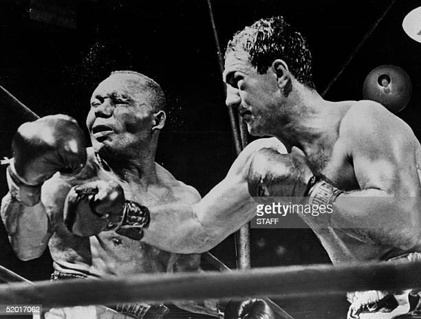 American boxing champion Rocky Marciano throws a right swing to his country fellow heavyweight boxing world champion Joe Walcott September 1952 in...