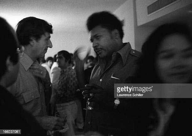 American boxing promoter Don King and unidentified others attend a reception at the Hilton Hotel Manila Philippines mid to late September 1975 King...