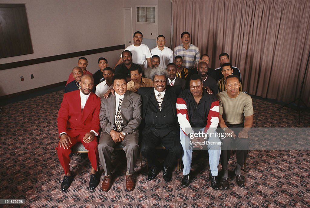 American boxing promoter Don King with some of the fighters he has worked with, New York City, 1997. Among them are boxing champions Muhammad Ali and Larry Holmes.