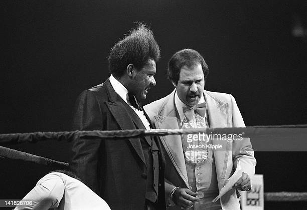 American boxing promotor Don King and an unidentified man in the ring during a Heavyweight Championship bout between American Muhammad Ali and...
