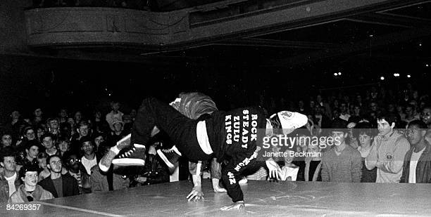 The crowd watches two unidentified breakdancers perform their routines on the stage at a nightclub in London 1982 A jacket worn by one dancer would...