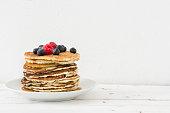 American breakfast. Pancakes with raspberries and blueberries