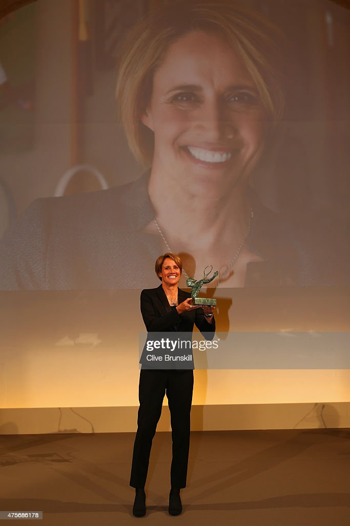 American broadcaster Mary Carillo poses with the Philippe Chatrier Award at the ITF World Champions Gala Dinner after day ten of the 2015 French Open...