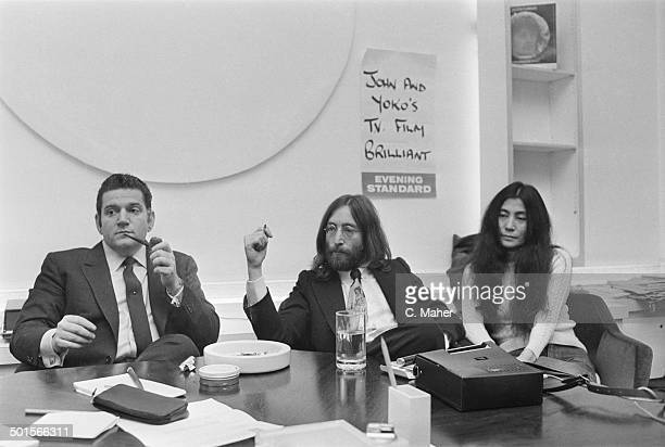 American businessman Allen Klein with John Lennon of The Beatles and Lennon's wife Yoko Ono 29th April 1969 Klein is representing Lennon in...