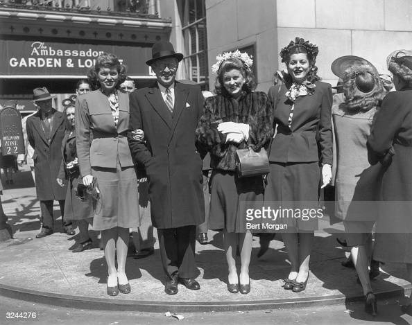 American businessman and ambassador Joseph P Kennedy Sr links arms with his daughters Eunice Kennedy Rosemary Kennedy and Patricia Kennedy as they...