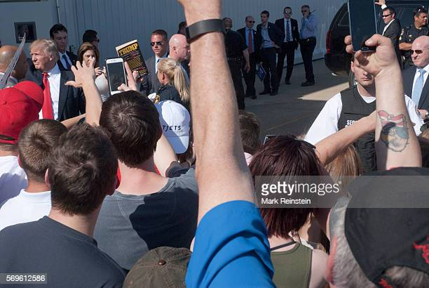 American businessman and Republican Presidential candidate Donald Trump walks through a crowd during a rally at Eppley Airfield Omaha Nebraska May 6...