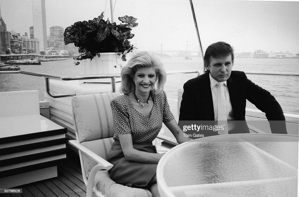 American businessman Donald Trump and his wife Ivana sit at a table on board their luxury yacht The Trump Princess, anchored outside the Water Club, New York City, July 1988.