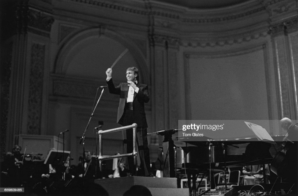 American businessman Donald Trump conducts the New York Pops Orchestra in a rendition of 'New York New York' in the grand finale of the orchestra's...
