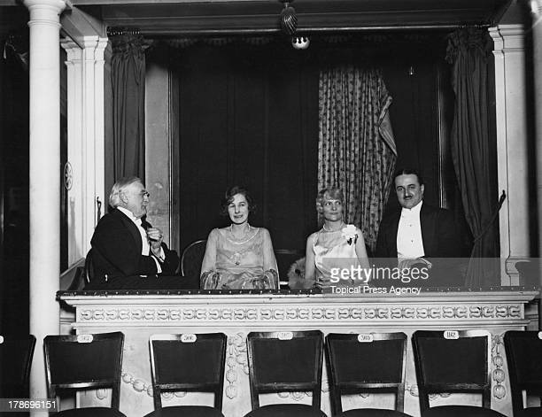 American businessman Harry Gordon Selfridge founder of Selfridges department store with guests in his private box at a New Year's charity ball held...