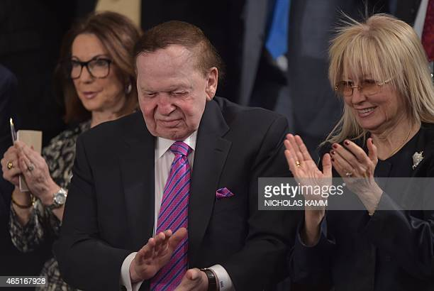 American businessman Sheldon Adelson applauds next to his wife Miriam Adelson as Israeli Prime Minister Benjamin Netanyahu addresses a joint meeting...