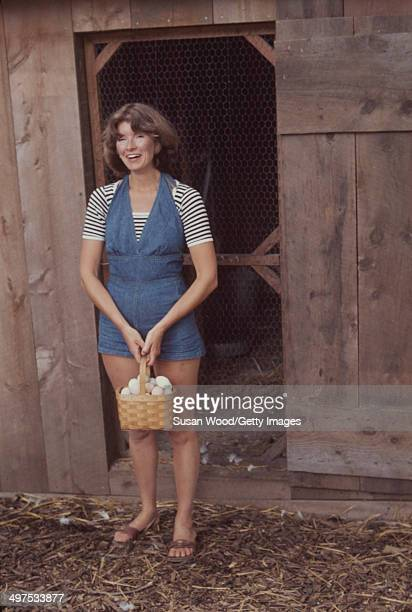 American businesswoman Martha Stewart carries a basket of eggs from a chicken coop on the grounds of her home Westport Connecticut August 1976