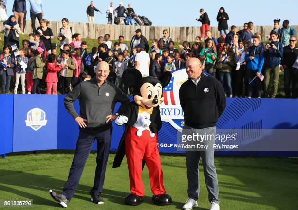 American captain Jim Furyk and European captain Thomas Bjorn pose with Mickey Mouse during a media event ahead of the 2018 Ryder Cup at Le Golf...